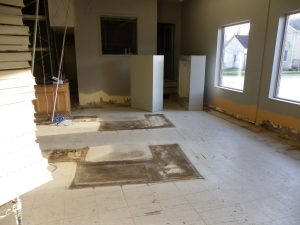 old cashier area cleared out and old badly stained floors remain