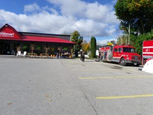 Paisley firement have their trucks on display at the BBQ on the porch fundraiser for the Paisley food bank
