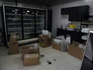 supplies come out of storage for the deli June 9